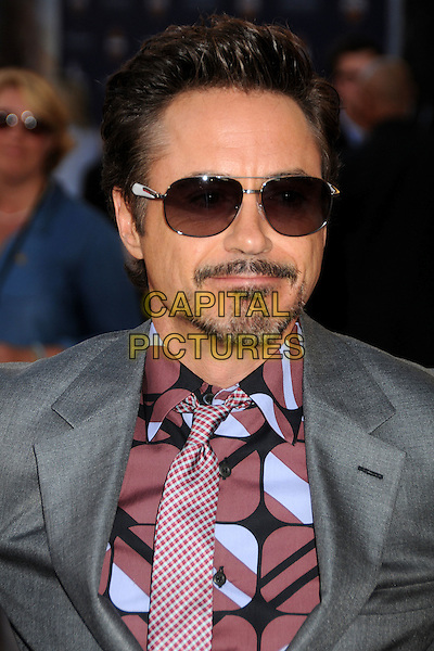 "Robert Downey Jr..Premiere of ""Captain America: The First Avenger"" held at The El Capitan Theatre in Hollywood, California, USA..July 19th, 2011.headshot portrait pink grey gray sunglasses shades goatee facial hair   .CAP/ADM/BP.©Byron Purvis/AdMedia/Capital Pictures."