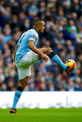 09.12.2012 Manchester, England. Manchester City's Belgian defender Vincent Kompany in action during the Premier League game between Manchester City and Manchester United from the Etihad Stadium. Manchester United scored a late winner to take the game 2-3.