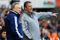 (L-R) Cardiff manager Neil Warnock speaks with colleague Ronnie Jepson during the Sky Bet Championship match between Swansea City and Cardiff City at the Liberty Stadium, Swansea, Wales, UK. Sunday 27 October 2019