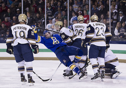 January 18, 2013:  Notre Dame defenseman Stephen Johns (28) checks Alaska left wing Garrick Perry (12) during NCAA Hockey game action between the Notre Dame Fighting Irish and the Alaska Nanooks at Compton Family Ice Arena in South Bend, Indiana.  Alaska defeated Notre Dame 5-4.
