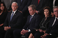 U.S. Vice President Mike Pence looks over at former President George W. Bush as he sits with former first lady Laura Bush at a memorial service for his father former President George H.W. Bush in the U.S. Capitol Rotunda in Washington, U.S., December 3, 2018. <br /> CAP/MPI/RS<br /> &copy;RS/MPI/Capital Pictures