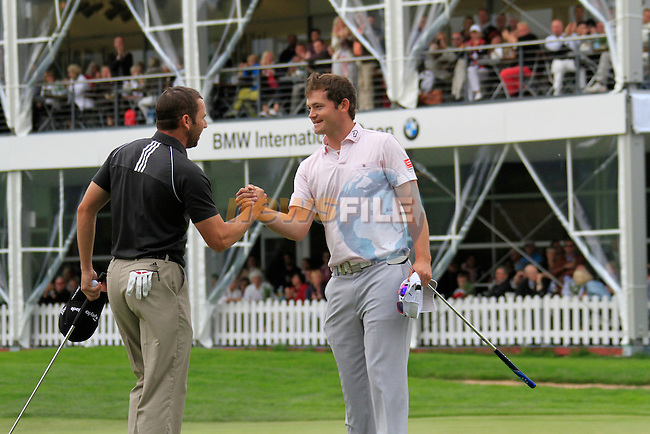 Gary Boyd (ENG) and Sergio Garcia (ESP) finish their round on the 18th green during of Day 3 of the BMW International Open at Golf Club Munchen Eichenried, Germany, 25th June 2011 (Photo Eoin Clarke/www.golffile.ie)