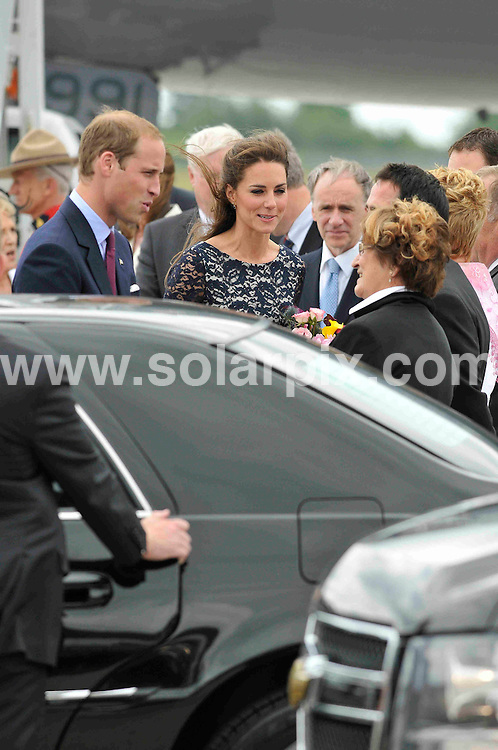 **ALL ROUND PICTURES FROM SOLARPIX.COM**                                             **WORLDWIDE SYNDICATION RIGHTS**                                                                                  Caption: Prince William and Princess Catherine, aka Kate Middleton, The Duke and Duchess of Cambridge, arrive on the royal flight at Ottawa Airport to begin their Royal Tour of Canada, their first royal tour since their wedding. Ottawa, Canada. 30 June 2011                                                                           This pic: Prince William and Princess Catherine                                                                                             JOB REF: 13649 MSR       DATE: 30_06_2011                                                           **MUST CREDIT SOLARPIX.COM OR DOUBLE FEE WILL BE CHARGED**                                                                      **MUST AGREE FEE BEFORE ONLINE USAGE**                               **CALL US ON: +34 952 811 768 or LOW RATE FROM UK 0844 617 7637**