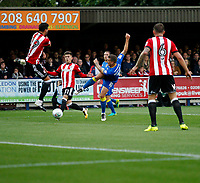 AFC Wimbledon's Cody McDonald has his shot blocked during the Carabao Cup match between AFC Wimbledon and Brentford at the Cherry Red Records Stadium, Kingston, England on 8 August 2017. Photo by Carlton Myrie.