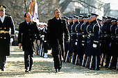 United States President Barack Obama (R) walks with French President Francois Hollande for a military review during a welcoming ceremony on the South Lawn at the White House on February 11, 2014 in Washington, DC. Hollande who arrived yesterday for a three day state visit, visited Thomas Jefferson's Monticello estate and will be the guest of honor for a state dinner tonight. <br /> Credit: Chip Somodevilla / Pool via CNP