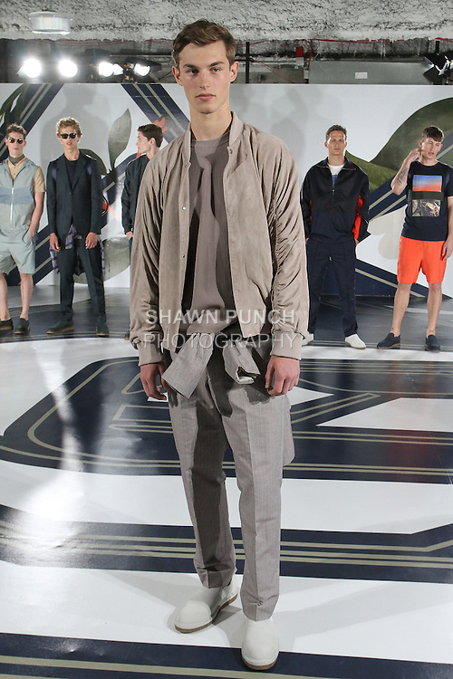 Model Kit poses in a suede bomber in quartz, nylon crew neck in quartz and jacquard suit in quartz, from the Perry Ellis Spring 2017 collection by Michael Maccari, on July 11th 2017, during New York Fashion Week Men's Spring Summer 2017.