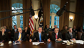 "United States  President George W Bush meets with his cabinet in the Cabinet Room of the White House 23 February, 2006 in Washington, DC.  President Bush announced the release of a White House report on the response to Hurricane Katrinia. In his remarks to the pool The President stated ""We will learn from lessons of the past to better protect the American people.""  From left to right: United States Secretary of the Interior Gale Norton, United States Secretary for Homeland Security Michael Chertoff, The President, United States Secretary of Defense Donald Rumsfeld, and United States Secretary of Commerce Carlos Gutierrez.  Also visible in the photo is Frances Fragos Townsend, Assistant to the President for Homeland Security and Counterterrorism (next to the American flag between Secretary Chertoff and The President) and Peter Pace, Chairman of the Joint Chiefs of Staff (back row between Secretary Rumsfeld and Secretary Gutierrez).<br /> Credit: Brendan Smialowski - Pool via CNP"
