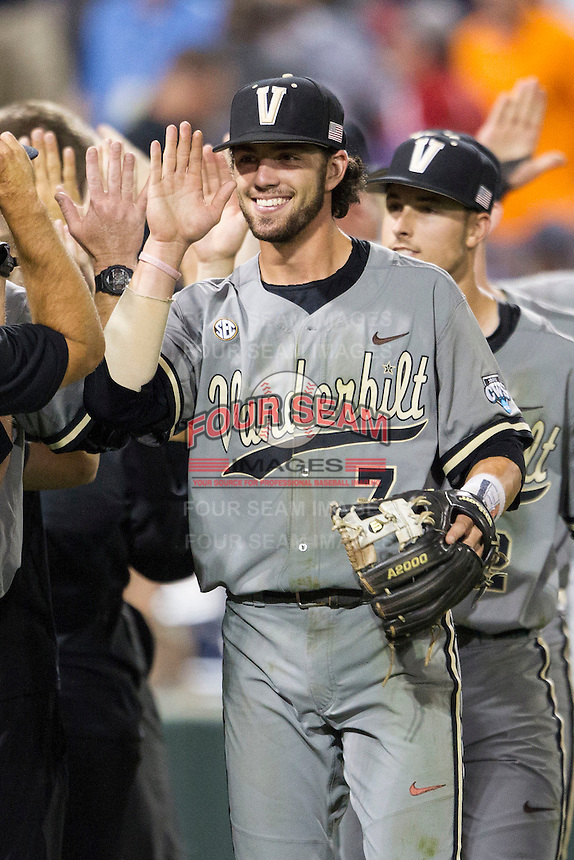 Vanderbilt Commodores shortstop Dansby Swanson (7) celebrates with his teammates following the NCAA College baseball World Series against the TCU Horned Frogs on June 16, 2015 at TD Ameritrade Park in Omaha, Nebraska. Vanderbilt defeated TCU 1-0. (Andrew Woolley/Four Seam Images)