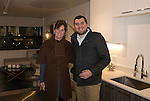 Roberta Ross and Ryan Rife tour a model apartment during the 3rd Street Flats Grand Opening in downtown Reno on Jan. 24, 2017.