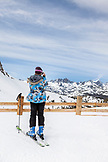 USA, California, Mammoth, a female skier takes a break to snap a photo of the captivating scenery at Mammoth Ski Resort