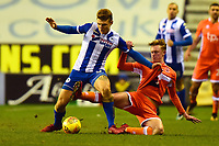 Wigan Athletic's Max Power tangles with Blackpool's Sean Longstaff<br /> <br /> Photographer Richard Martin-Roberts/CameraSport<br /> <br /> The EFL Sky Bet League One - Wigan Athletic v Blackpool - Tuesday 13th February 2018 - DW Stadium - Wigan<br /> <br /> World Copyright &copy; 2018 CameraSport. All rights reserved. 43 Linden Ave. Countesthorpe. Leicester. England. LE8 5PG - Tel: +44 (0) 116 277 4147 - admin@camerasport.com - www.camerasport.com