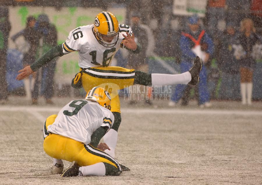 Nov. 27, 2006; Seattle, WA, USA; Green Bay Packers punter (9) Jon Ryan holds as kicker (16) Dave Rayner kicks a field goal against the Seattle Seahawks at Qwest Field in Seattle, Washington. Mandatory Credit: Mark J. Rebilas