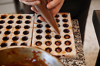 Chocolatier Patrice Arbona filling chocolates, 'Entre Mes Chocolats', Vence, France, 10 February 2011