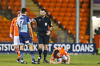 Referee Eddie Ilderton talks to Luke O'Nien of Wycombe Wanderers as Jack Redshaw of Blackpool is floored during the The Checkatrade Trophy match between Blackpool and Wycombe Wanderers at Bloomfield Road, Blackpool, England on 10 January 2017. Photo by Andy Rowland / PRiME Media Images.