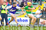 Cian Hussey Saint Brendans in action against John Griffin Lixnaw in the Senior County Hurling Final at Austin Stack Park Tralee on Sunday.
