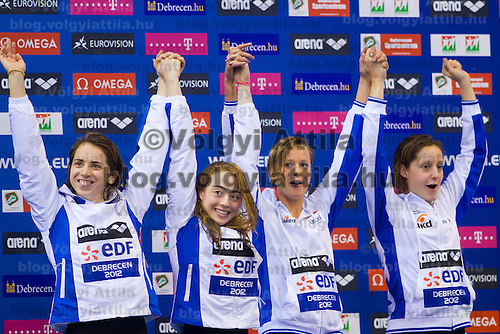 Members of Team Italy Alice Mizzau, Alice Nesti, Diletta Carli and Federica Pellegrini celebrate their victory in the Women's 4x200m Freestyle Relay of the 31th European Swimming Championships in Debrecen, Hungary on May 23, 2012. ATTILA VOLGYI