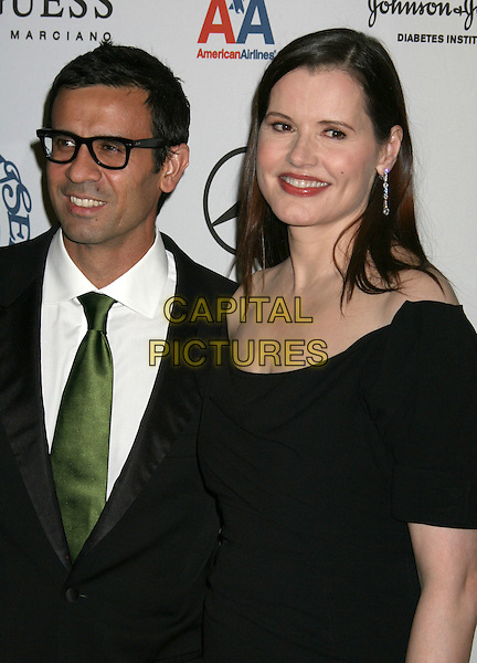 REZA JARRAHY & GEENA DAVIS.30th Annual Carousel of Hope Ball to benefit the Barbara Davis Center for Childhood Diabetes held at the Beverly Hilton Hotel, Beverly Hills, California, USA..October 25th, 2008.half length black suit jacket dress green tie glasses married husband wife.CAP/ADM/MJ.©Michael Jade/AdMedia/Capital Pictures.