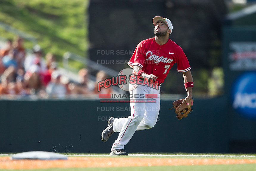 Houston Cougars shortstop Frankie Ratcliff (7) tracks a pop fly during the NCAA baseball game against the Texas Longhorns on June 6, 2014 at UFCU Disch–Falk Field in Austin, Texas. The Longhorns defeated the Cougars 4-2 in Game 1 of the NCAA Super Regional. (Andrew Woolley/Four Seam Images)