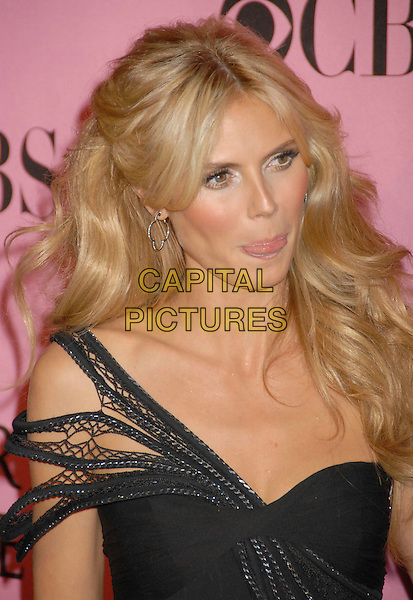 HEIDI KLUM .2007 Victoria's Secret Fashion Show Arrivals held at the Kodak Theatre, Hollywood, California, USA,.15 November 2007..portrait headshot gold hoop flower earring black shoulder straps tongue mouth funny face.CAP/ADM/BP.©Byron Purvis/AdMedia/Capital Pictures.
