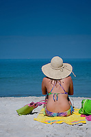 Girl on beach with a hat in swimsuit. Gulf of Mexico at beach near Naples Fishing Pier, Naples, Florida, USA. Photo by Debi Pittman Wilkey