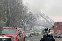 NEW YORK - FOR NEWS:  Building explosion, East 116th Street, between Madison and Park Aves, Harlem, NY Wednesday, March 12, 2014.  <br /> <br /> PICTURED:   Police officer at the scene of the building explosion.<br /> <br /> (Angel Chevrestt, 646.314.3206)
