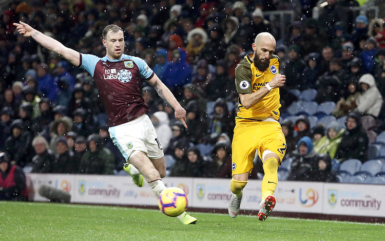 Brighton & Hove Albion's Bruno Saltor passes under pressure from Burnley's Ashley Barnes<br /> <br /> Photographer Rich Linley/CameraSport<br /> <br /> The Premier League - Burnley v Brighton and Hove Albion - Saturday 8th December 2018 - Turf Moor - Burnley<br /> <br /> World Copyright © 2018 CameraSport. All rights reserved. 43 Linden Ave. Countesthorpe. Leicester. England. LE8 5PG - Tel: +44 (0) 116 277 4147 - admin@camerasport.com - www.camerasport.com