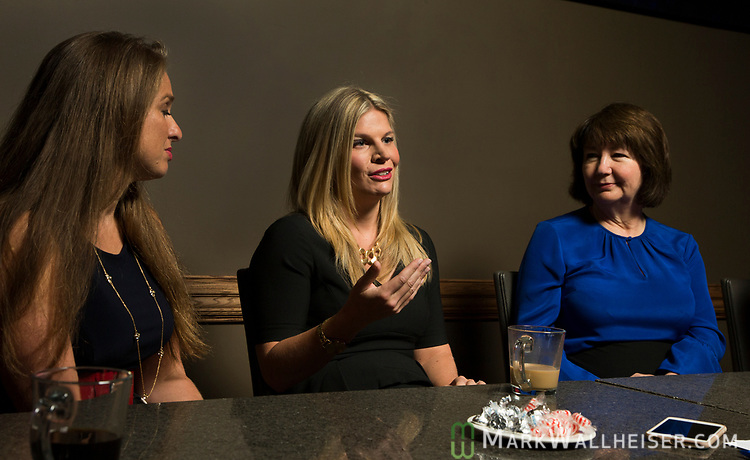 Lobbyist Andrea Reilly, center, talks as Monica Rodriguez, left and Keyna Cory listen during a Florida Women Lobbyist round table at the Blue Halo Restaurant in Tallahassee, Florida.