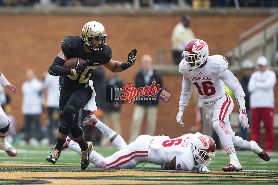K.J. Brent (80) of the Wake Forest Demon Deacons looks to give a stiff arm to Rashard Fant (16) of the Indiana Hoosiers during first half action at BB&T Field on September 26, 2015 in Winston-Salem, North Carolina.  The Hoosiers defeated the Demon Deacons 31-24.  (Brian Westerholt/Sports On Film)