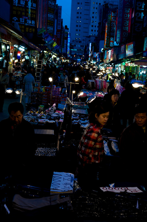 Outdoor market at night in Seoul, South Korea.