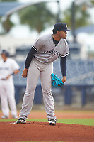 Tampa Yankees relief pitcher Jose Mesa (52) looks in for the sign during the first game of a doubleheader against the Charlotte Stone Crabs on July 18, 2017 at Charlotte Sports Park in Port Charlotte, Florida.  Charlotte defeated Tampa 7-0 in a game that was originally started on June 29th but called to inclement weather.  (Mike Janes/Four Seam Images)