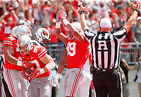 Teammates congratulate Ohio State Buckeyes defensive end Nick Bosa (97) after he recovered a fumble in the end zone for a touchdown during the second quarter of a NCAA college football game between the Ohio State Buckeyes and the Oregon State Beavers on Saturday, September 1, 2018 at Ohio Stadium in Columbus, Ohio. [Joshua A. Bickel/Dispatch]
