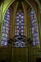 Medieval stained glass Window of the Gothic Cathedral of Chartres, France - dedicated to the Life of St Remigius (Remy). Left window - Life of St Remigius, centre - Life and relics of St Stephen, right - Life and miracles of St Nicholas.  A UNESCO World Heritage Site..