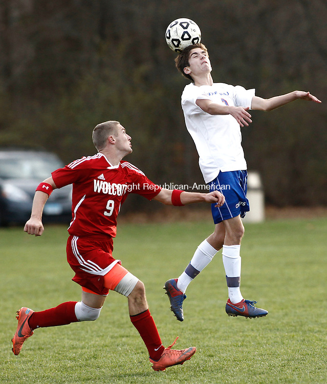 Woodbury, CT- 03 November 2013-110513CM04- Nonnewaug's Jack Kingdon jumps up to head the ball against  Wolcott's Daniel Neal during their Class M matchup in Woodbury Tuesday afternoon.  Nonnewaug, won 3-0.      Christopher Massa Republican-American
