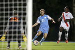 18 October 2013: North Carolina's Cooper Vandermaas-Peeler (21) moves between Syracuse's Alex Bono (25) and Jordan Murrell (CAN) (4). The University of North Carolina Tar Heels hosted the Syracuse University Orangemen at Fetzer Field in Chapel Hill, NC in a 2013 NCAA Division I Men's Soccer match. UNC won the game 1-0.