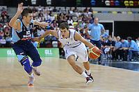 GB's Devon Van Oostrum goes past Nemanja Gordic of Bosnia & Herzegovina during the EuroBasket 2015 2nd Qualifying Round Great Britain v Bosnia & Herzegovina (Euro Basket 2nd Qualifying Round) at Copper Box Arena in London. - 13/08/2014