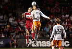 05 June 2009: Houston's Geoff Cameron (right) outjumps Chicago's Brian McBride (left) to a header. The Houston Dynamo defeated the Chicago Fire 1-0 at Toyota Park in Bridgeview, Illinois in a regular season Major League Soccer game.