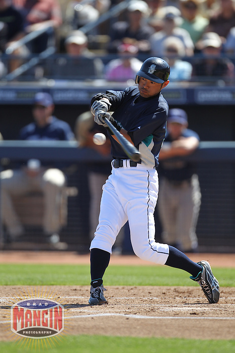 PEORIA - MARCH 5:  Ichiro Suzuki of the Seattle Mariners bats during a spring training game against the San Diego Padres on March 5, 2010 at the Peoria Sports Complex in Peoria, Arizona. (Photo by Brad Mangin)