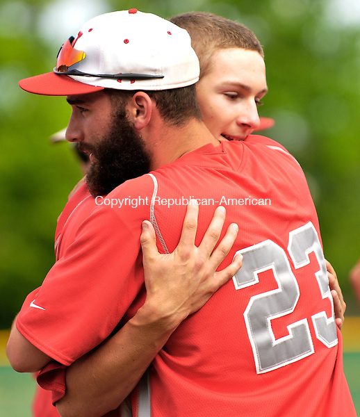 WATERBURY, CT - 24 May 2012-052412EC07--   Wolcott's Sean Begley (23) embraces Daniel Neal (26) after the Eagles' loss.  Derby won 2-1 Thursday afternoon at Municipal Stadium in Waterbury.  Erin Covey Republican American.