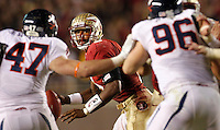 TALLAHASSEE, FL 11/19/11-FSU-UVA111911 CH-Florida State's EJ Manuel  scrambles on Virginia during first half action Saturday at Doak Campbell Stadium in Tallahassee. .COLIN HACKLEY PHOTO