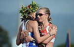 KAILUA-KONA, HI - OCTOBER 13:  Leanda Cave of Great Britain hugs  Caroline Steffan of Switzerland finishing 1st and 2nd respectively during the 2012 IRONMAN World Championships on October 13, 2012 in Kailua-Kona, Hawaii. (Photo by Donald Miralle)