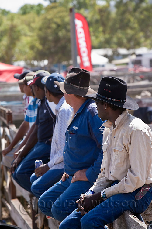 Indigenous cowboys watching the action at the annual Mt Garnet Rodeo.  Mt Garnet, Queensland, Australia