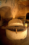 Israel, the Shephelah region, Olive press at Hazan Cave from the Bar Kokhva revolt period