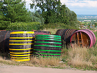 France, FRA, Département Rhone, Beaujolais, Fleurie, 2009Jul23: Worn out wine barrels at the roadside.