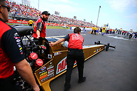Apr 22, 2017; Baytown, TX, USA; NHRA top fuel driver Leah Pritchett and crew members during qualifying for the Springnationals at Royal Purple Raceway. Mandatory Credit: Mark J. Rebilas-USA TODAY Sports
