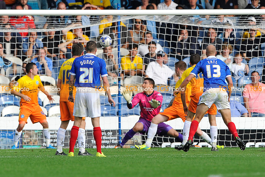Jonannes Ertl of Portsmouth right scores the equaliser agaist goalkeeper Matt Ingram of Wycombe Wanderers - Portsmouth vs Wycombe Wanderers - Sky Bet League Two Football at Fratton Park, Portsmouth, Hampshire - 20/09/14 - MANDATORY CREDIT: Denis Murphy/TGSPHOTO - Self billing applies where appropriate - contact@tgsphoto.co.uk - NO UNPAID USE