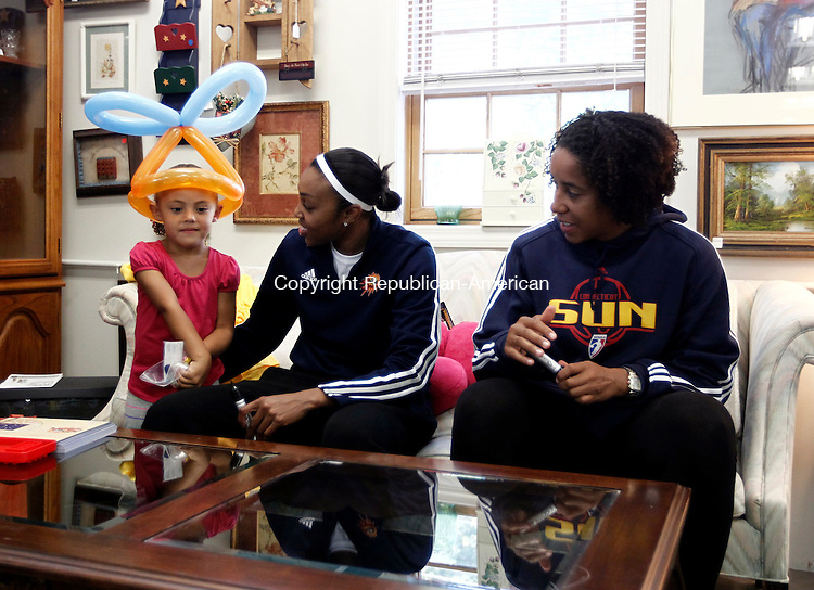 Waterbury, CT- 14 August 2014-081414CM01-  Karina Ortiz, 4, left of Waterbury talks with WNBA basketball stars  Renee Montgomery, left, and Nykesha Sales, at Acts 4 Ministry in Waterbury on Thursday.  The pair, who formerly played at UConn, now play for the Connecticut Sun.  They were signing autographs and helping raising money for Act 4 Ministry's Back to School drive.  With the donations that were raised on Thursday, will help fund the school uniform program which provides school clothing for area kids at nominal rate said Sara Elizabeth Carabetta, executive director at Acts 4 Ministry.  She added they have handed 173 uniforms from August 4th to August 13th and expect that number to exceed over 400 this month.   Christopher Massa Republican-American