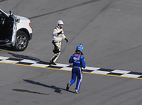 Apr 26, 2009; Talladega, AL, USA; NASCAR Sprint Cup Series driver Carl Edwards runs across the finish line after flipping over on the last lap during the Aarons 499 at Talladega Superspeedway. Mandatory Credit: Mark J. Rebilas-