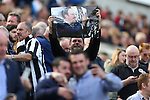 A fan holds up a photo of Rafa Benitez, manager of Newcastle United during the Barclays Premier League match at St James' Park. Photo credit should read: Philip Oldham/Sportimage