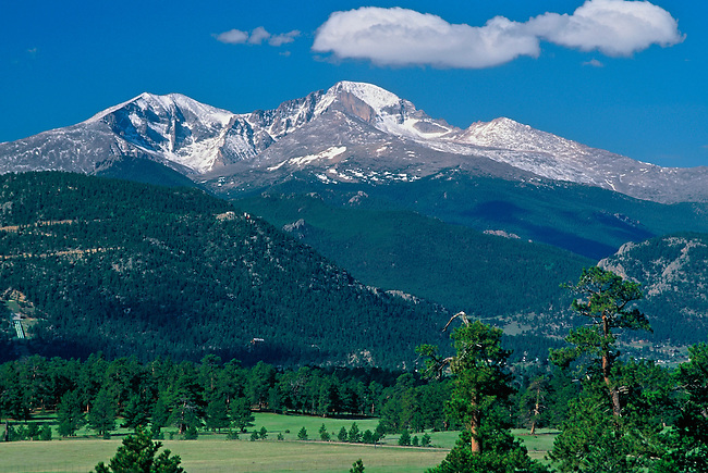 The Three Peaks (Mt. Meeker, Longs Peak, Mt. Lady Washington) watch over the valley of Estes Park, Colorado.