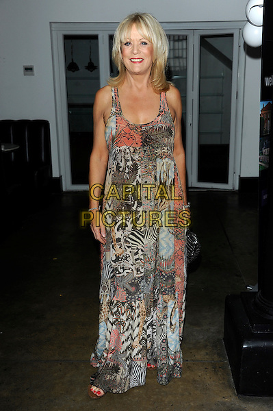 Sherrie Hewson.Welch Morgan Locations launch party at The Collection, Brompton Road, London, England.June 28th 2012.full length dress zebra leopard print dress beige pink.CAP/CJ.©Chris Joseph/Capital Pictures.